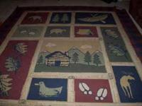 Large room rug for sale. Would be great in a cabin or