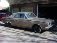 This is a 1963 Dodge Dart 270 convertible. It is a 225