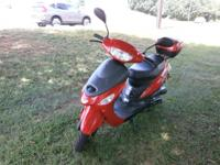 it is a taotao 50 cc red like new 55 km only driven