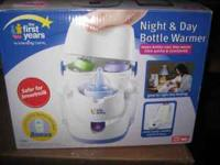 Night and Day Bottle Warmer. Heats up bottles by steam
