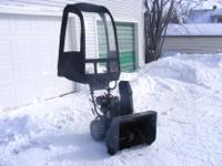 "24"" Murray Performance snow blower with a brand new cab"
