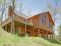 Like new D-log home with wrap around deck. Great room