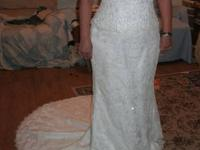 I have a beautiful strapless Mori Lee wedding dress in