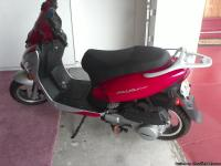 Street capable, gasoline run motor scooter.  Has