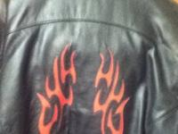 Heavy leather riding jacket, great for cool weather