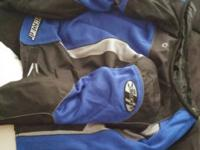 Black, blue, and silver Joe Rocket jacket. Brand name