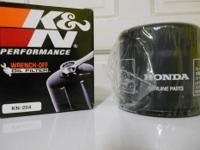Two oil filters, new, same size / different brands. K &