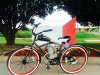 ". An exciting MOTORIZED bike. Huffy 26"" tall Cruiser"