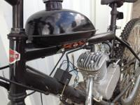 This is new 80cc motor, mounted to a 15-speed Harley