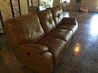 Light brown motoried sofa for sale. The 2 external