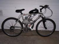 For sale is my mountainbike with 66cc two stroke