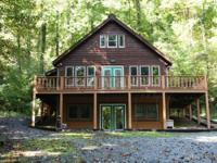 Mountain cabin on 3 ac surrounded by trees and