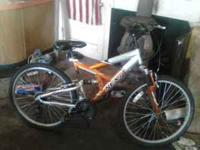 The bike is a 26inch orange and silver , and has front
