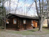 Cedar log cabin, duplex, with creekfront property (1/2
