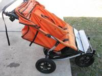 Mountain Buggy double stroller orange in color. Cost
