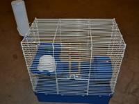 Mouse cage with accesories that include: food dish,