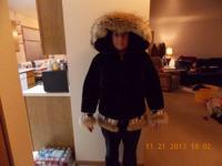 Black Mouton Sheep fur coat.  Very warm.  Has coyote