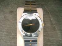USED MOVADO WATCHES, $350.00 AND $600.00 I PURCHASED