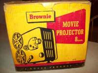 8mm movie projector still in the box, possibly never