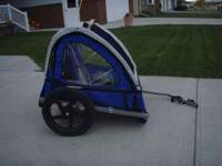 This bicycle trailer fits 2 children, up to 100 lbs.,