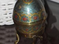 Metal Decorative Egg on Stand Price $10.00  Glass