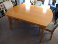 Solid wood kitchen table  $125  Comes with two leaves