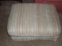 Have for sale a nice neutral color ottoman from a smoke