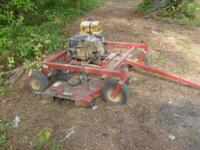 For sale: 60 inch pull behind Swisher lawn mower. 16 HP