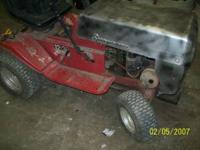 for sale is a 12 hp riding lawn mower runs and drives