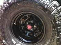 Selling a set of four rims and tires. Mickey Thompson