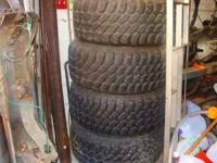 Four 35x12.50x15 Dunlop Mud Rovers with 90% tread
