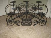 Beautiful black iron candle holder. Holds 8 candles!