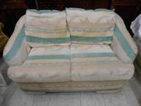 Beautiful Loveseat in Good Condition, a minor rip (as