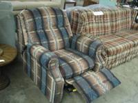 Comfortable recliner with versatile multicolor fabric.