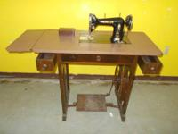This is a 1920's Mundlos 15 treadle stitching machine