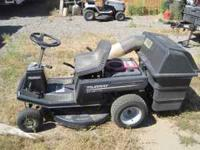 "This is a 30"" 12hp Murray riding lawn mower. Has rear"
