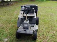 Ridding mower with bagger in Great Condition, $450.00.