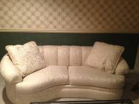 A beautiful couch for sale in Sterling. VERY FAINT