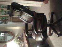 3 leather brown office chairs , swivel with castors in
