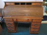 This is a beautifully crafted roll top desk! Priced to