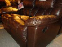 This all brown leather rocking recliner is a beacon of
