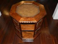 The solid wood side table is an octagon shape. It