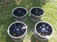 Like new set of Ford Racing GT500 rims in black with a