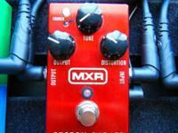 This is a mint MXR Custom Badass '78 Distortion pedal.
