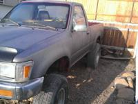 89 Toyota pickup, interior is in good shape exterior in