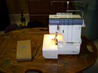 Used  New Home Mylock 334 Serger sewing machine in