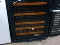 We have this N'FINITY wine cooler. Model # 277012103.