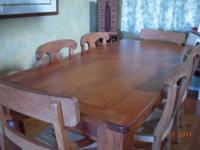 This lovely dining table is made of yellow pine and