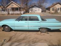 Teal colored classic 1961 Ford Fairlane 500.