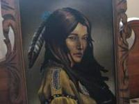 I have a canvas painting of a Native American Female I